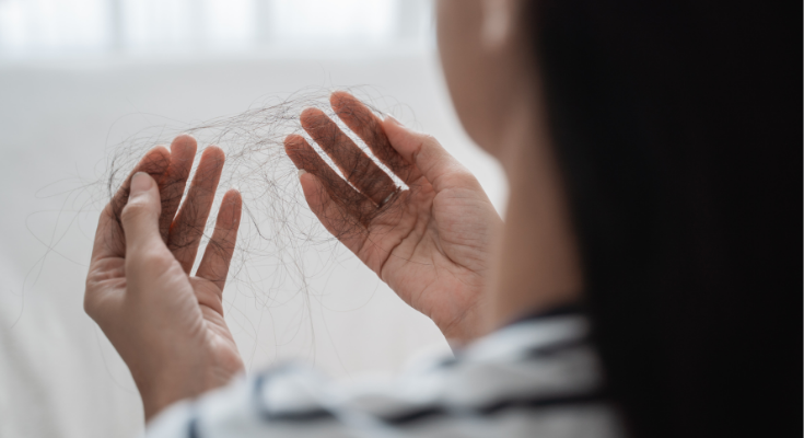 Hair Thinning in Females: What Causes It & How To Fix It